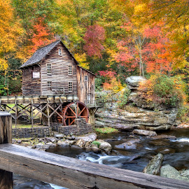 Glade Grist Mill in the Fall by Lawayne Kimbro - Buildings & Architecture Other Exteriors ( mill, glade grist, stream, red, mountain, autumn, old mill, colors, fall, waterfall, yellow, bridge )