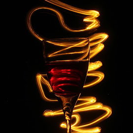 a glass of wine by Dogu Cetin - Food & Drink Alcohol & Drinks ( wine, red wine, wine glass, glass, light )