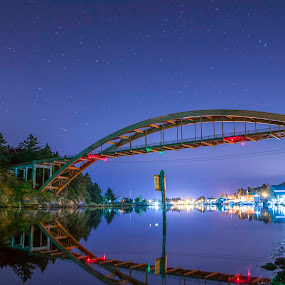 Rainbow at night by Eddie Murdock - Buildings & Architecture Bridges & Suspended Structures ( water, reflection, night, bridge, rainbow, channel )