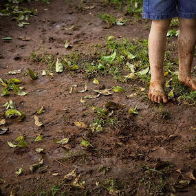 Playing in the mud by Nardus Taljard - Babies & Children Hands & Feet ( child, mud, play, toddler, rain )