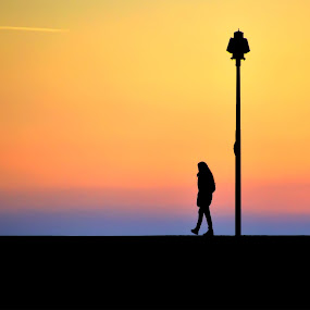 Alone at sunset by Luigi Alloni - Landscapes Sunsets & Sunrises ( woman sunset sea alone camogli g.hostbuster )