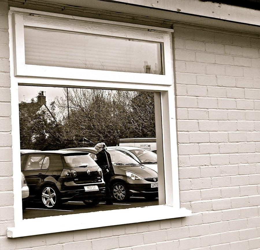 Car park window reflection by Yvonne Katcher - Buildings & Architecture Other Exteriors ( reflection, window, cars, woman, car park )