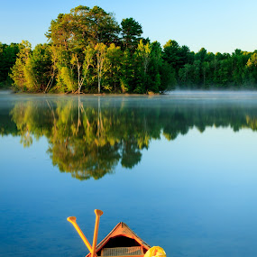 My Blue Canoe by Tom Whitney - Transportation Boats ( water, vertical, paddles, wood, maine, old town, canoe, lake, sunrise, boat, island, , relax, tranquil, relaxing, tranquility )