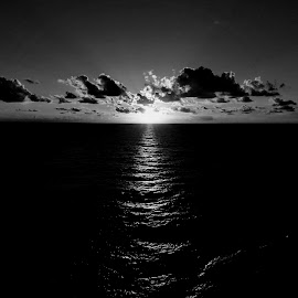 Sunrise on Cruise by Chris Gray - Black & White Landscapes ( clouds, ocean, sunrise, rays )