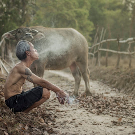 Smoking by Sutiporn Somnam - People Portraits of Men ( cigarette, stop, concept, no, thai, unhealthy, yellow, object, quit, hand, risk, chills, danger, life, habit, style, narcotic, toxic, lifestyle, addict, addiction, butt, men, end, man, closeup, animal, buffalo, nicotine, death, white, bad, health, smoke, product, lung, ash, the man, pet, quitting, background, tobacco, local, cancer )