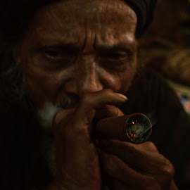 Smoking Divine by Arnab Bhattacharyya - People Portraits of Men ( divine, monk, sage, bong, dark, india, smoke, black, marijuana )