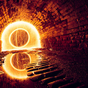 Light at the End of the Tunnel by Pete Barnes - Abstract Light Painting ( reflection, wheel, brick, industy, circle, photography, flame, cobble, dark, photographer, spin, pete barnes, long exposure, sparks, light, eye, orange, ring, art, professional, urban, light painting, orb, catherine wheel, tunnel )