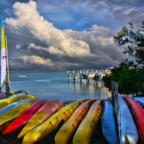 Colorful Canoes by Dennis Granzow - Landscapes Waterscapes ( bay, dramatic clouds, florida, digital art, canoes )