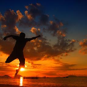 SUNSET JUMP by Assoka Andrya - People Portraits of Men