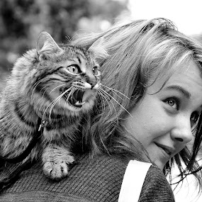 Girl With Cat (black & white) by Gabriel Tocu - Black & White Street & Candid ( cat, girl, black and white, street & candid, street scene, people, street photography )