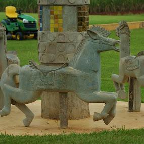 Concrete carousel by Jason C Robinson - Buildings & Architecture Statues & Monuments ( concrete, still, statue, playground, carousel, roundabout, horses )