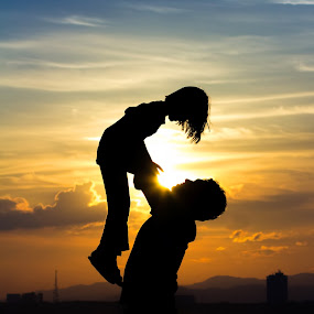 Silhouette of Father and daughter on the Beach by Shahril Khmd - People Family ( hug, silhouette, little, beach, people, together, kid, love, married, family, lifestyle, care, enjoyful, summertime, cheerful, black, hold, white, parent, son, young;, fun, dusk, portrait, country, emotion, outdoors, outside, shore, daddy, daughter, cute, sun, father, hand, child, girl, happy, baby, evening, man, sand, male, beautiful, marriage, relationship, two, sunset, outdoor, background, summer, boy, beach; sun; hug; outdoor; shore; fun; emotion; sand; parent; love; daughter; lifestyle; care; kid; child; enjoyful; little; happy; baby; background; beautiful; black; boy; country; cute; daddy; dusk; evening; family; father; girl; hand; hold; male; man; marriage; married; outdoors; outside; people; portrait; relationship; silhouette; cheerful; son; summer; summertime; sunset; together; two; white; young; )