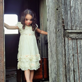 A New Beginning.  by Danny Robinson - Babies & Children Child Portraits ( trunk, vintage, pretty girl, dress, curls, train, toddler )