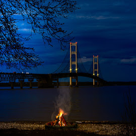 Mackinaw Bridge  by Eugene Linzy - Buildings & Architecture Bridges & Suspended Structures ( clouds, water, camp fire, night, lake, bridge, moonlight, fire )
