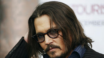 138755-cast-member-johnny-depp-arrives-for-the-premiere-of-the-tourist-in-new