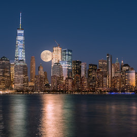 Perigee full moon over the skyscrapers of lower Manhattan-New Yo by Jan Gorzynik - City,  Street & Park  Skylines ( reflection, moon, skyline, lower, harbor, metropolis, america, colorful, metropolitan, apartment, architecture, nyc, cityscape, usa, panorama, coast, city, modern, sky, skyscraper, full, york, east, perigee, building, twilight, manhattan, urban, landmark, new, waterfront, brooklyn, river )