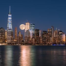 Perigee full moon over the skyscrapers of lower Manhattan-New Yo by Jan Gorzynik - City,  Street & Park  Skylines ( reflection, moon, skyline, lower, harbor, metropolis, america, colorful, metropolitan, apartment, architecture, nyc, cityscape, usa, panorama, coast, city, modern, sky, skyscraper, full, york, east, perigee, building, twilight, manhattan, urban, landmark, new, waterfront, brooklyn, river )
