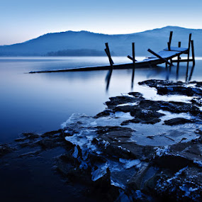 Frozen Jetty at Derwent Water by Pete Barnes - Landscapes Waterscapes ( calm, water, reflection, uk, wreck, ruin, lakes, frost, derwent, still, jetty, morning, derwent water, lake district, colour, mountains, cold, blue, ice, scene, pier, evening, frosty )