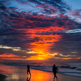 For you may never love like this again by Mahdi Hussainmiya - Landscapes Sunsets & Sunrises ( clouds, wet sand, sunset, silhouette, action, sea, reflections, couple, chase, romance, dusk, running,  )
