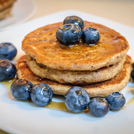 Vegan pancakes by Eva Krejci - Food & Drink Cooking & Baking ( plate, spelt flour, pancakes, maple syrup, blueberries )