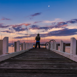 Fishing under the moon. by Keith Walmsley - Buildings & Architecture Bridges & Suspended Structures ( victoria, coast, pier, moon, sunset, australia, clouds, boats, angler, water, landscape )