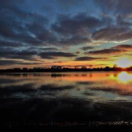 Golden Glow by Kathy Woods Booth - Landscapes Sunsets & Sunrises ( reflection, sunset, twilight, reflections, dusk )
