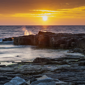 Sunset at Torekov by Martin Hedlund - Nature Up Close Rock & Stone ( nikon d90 sweden skåne sunset water rock stone ocean shore sky nightfall dusk cloud clouds rocks )