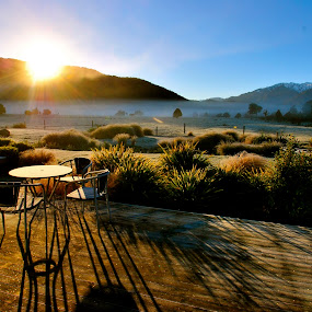 Sunrise around Lake Matheson by Alexsandra Wiciel - Landscapes Travel ( mountains, winter, nature, pwcpath, chairs, lanscape, frost, trees, forest, sunrise, table, new zealand )