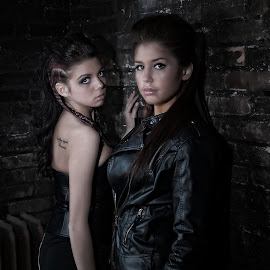 Mysterious Sisters by Justin Kime - People Portraits of Women ( grunge, sisters, low key, brick, leather )