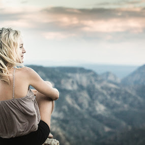 Watcher by Preston Trauscht - People Portraits of Women ( female, sunset, cliff, beautiful, blond, rock, overcast, cute, smile, landscape, natural, portrait, Free, Freedom, Inspire, Inspiring, Inspirational, Emotion )