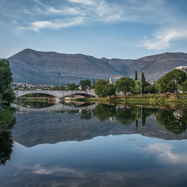 Reflection by Dusan Arezina - Landscapes Mountains & Hills ( sky, blue sky, mountain, green, reflection, town, blue, clouds, bridge, water, trees )