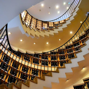 Staircase by Heather Aplin - Buildings & Architecture Other Interior ( wine, shop, staircase, rail, banister, bottles, spiral, light,  )