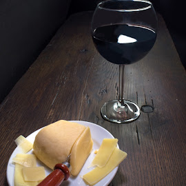 Wine & Cheese by Jim Downey - Food & Drink Meats & Cheeses ( dark table, lighting, red wine, cut cheese, evening )