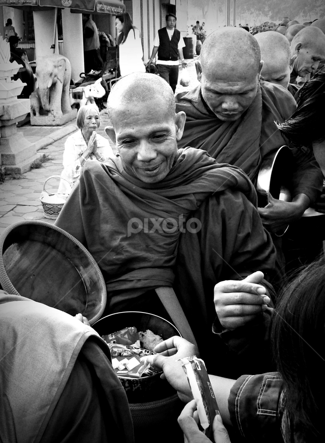 Gifts. by Ian Gledhill - People Street & Candids ( monks, new year, black and white, street, asia, buddhist, thailand, gifts, worship, pwccandidcelebrations, culture, b&w, portrait, people, city, photography, contest, theme, tradition, mind, challenge, , Travel, People, Lifestyle, Culture )