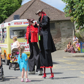 Tall People in Priory Park by Angie Keverne - Novices Only Street & Candid ( ice cream van, park, stilts, people, tall )