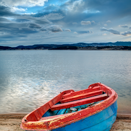 Boat on a lake in the mountains by Deyan Georgiev - Landscapes Waterscapes ( calm, reflection, europe, mountain, wood, lakes, travel, beauty, landscape, tranquil, mountains, sky, nature, autumn, sail, water, clouds, peaceful, park, national, green, beautiful, boats, romantic, forest, lake, tourism, scenic, boat, boating, vacation, blue, color, background, outdoor, cloud, summer, day, fishing, river )