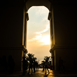 Gumul Gate by Alif Ahmada - Buildings & Architecture Statues & Monuments ( silhouette, sunset, architectural, architecture, people, gumul, city, gate )
