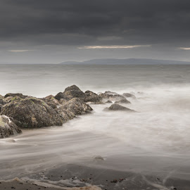 Salthill Waves by John Holmes - Landscapes Waterscapes ( clouds, sand, waves, galway, sea, wild atlantic way, overcast, beach, galway bay, sky, wave trails, long exposure, white water )