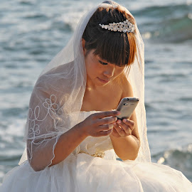 Spreading the News by Francisco Little - People Street & Candids ( bride, whitegown, smartphone, china, chat, online, socialmedia, wedding, text )