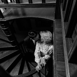 Stairs to love by Bugarin Dejan - Wedding Bride & Groom ( expression, gromme, black and white, beautiful, posing, pretty, photography, love, kiss, stairs, dark, lovely, couple, bride, light )
