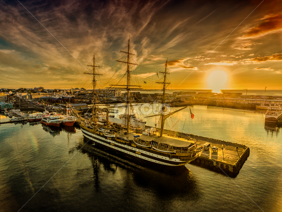 Amerigo Vespucci in sunset in Reykjavik Iceland by Kristvin Guðmundsson - Transportation Boats ( gold, sailboat, harbour, golden hour, sunset, iceland, travel, sailing, drone, boat )