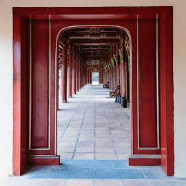Renovated Hallway of  the Imperial Citadel of Hue by Chantal Reed - Buildings & Architecture Architectural Detail ( red, doorways, hue, arches, hue imperial city, vietnam, paving )
