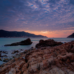 Rises by Anthony Lau - Landscapes Caves & Formations ( cloud formations, hong kong, sun rise, sea, sai kung, rock, beach, light, long ke, coast )