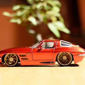 chevrolet corvette model  by Dipabrata Sur - Artistic Objects Toys ( car, red, toy, artistic, bokeh )