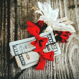 Romance and Finance by Rob Heber - Artistic Objects Other Objects ( folded bills, gift, wood, petals, still life, red ribbon, indoors, daisy, romance, wood grain background, currency, love, ribbon, money, flowers, closeup, wood grain, ideas, red bow, carnation, bloom, plant life, gift wrapped, concepts, close up, twenty dollar bill, present, wilting, red, paper money, cash, finance, stem, bow, hundred dollar bill, conceptual, overhead view, bills )
