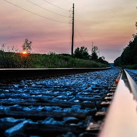 wisconsin railroad sunset by Jason Lockhart - Landscapes Sunsets & Sunrises ( wisconsin, railroad tracks, grass, sunset, dane county, utility poles )