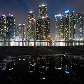 Marine city reflected by Geir Christensen - City,  Street & Park  Skylines ( lights, marine, reflection, skyline, towers, cityskape, busan, haeundae, korea, city )