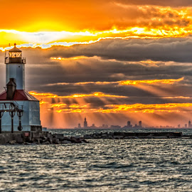 Lighthouse at Sunset by Lynn Kirchhoff - Buildings & Architecture Public & Historical ( clouds, indiana, orange, lighthouse, sea, lake, sun, michigan, sky, sunset, sunrays, pier, chicago )