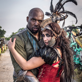 A Steampunk Affair by Amelia Falk - People Couples ( expression, costumes, fashion, faces, illinois, location, clothing, lively, fight, grrr, retro, dystopia, romance, people, fantasy, mad max, scenes, fantastical, composition, chicago, interesting, leather, steampunk, groups, interaction, fun, couples, shapes, models, lines, bodies, bleakness, feelings )
