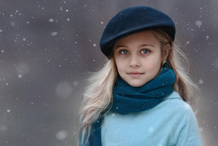 Virginia Snow by Angel Solomon Caracciolo - Babies & Children Child Portraits ( child, blonde, winter, girl, cold, blue, outdoors, snow, blond, blue eyes, scarf, outside, hat )
